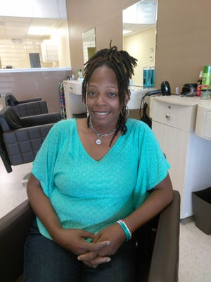 Nicole Boston recently started Upscales Hair Lounge with partner Jermaine Wilson in Palm Bay.