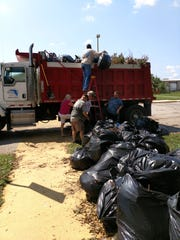 People help clean debris from LARC facility.