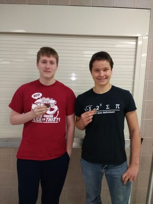 Thomas Foster, left, and Jacob Petrie display their medals earning from their performance during the latest meet.