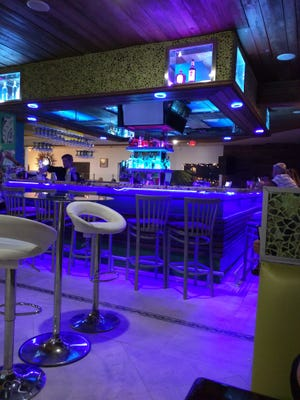 Inti's restaurant design is very fresh and contemporary. Pictured is the colorful bar.