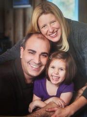 Erin Frayne with her husband Randy Frayne, and their