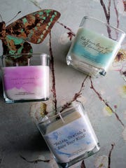 Scented candles created by Moshika White, owner of