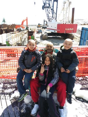 Timothy Jones and his children, twins Quarim and Quazim Jones and daughter Brianna in happier days. The children and mother  (not  subsequent auto accident..
