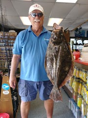 Len Semon of Berkeley Heights with a fluke over 9 pounds at Brielle Bait and Tackle.