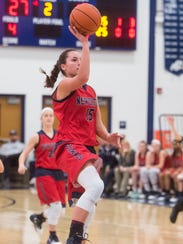 New Oxford's Haley Luckabaugh (15) shoots a last second