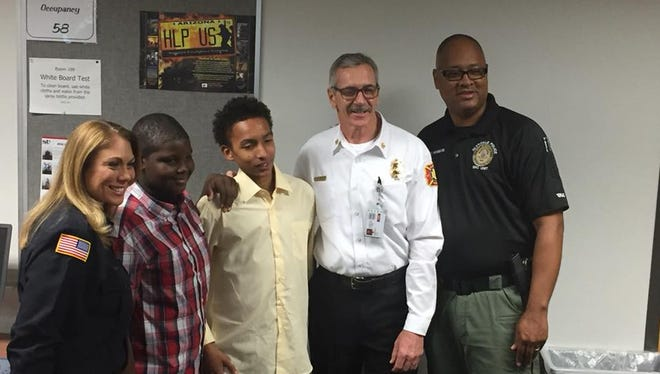 Malikah Barfield, 14, and Bryson Burris, 12, were honored by Glendale firefighters and police officers on Tuesday, Dec. 5, 2017.