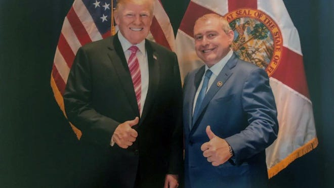 This undated image released by the House Judiciary Committee from documents provided by Lev Parnas to the committee in the impeachment probe against President Donald Trump, shows a photo of Lev Parnas with Trump in Florida. Parnas, a close associate of Trump's personal lawyer Rudy Giuliani is claiming Trump was directly involved in the effort to pressure Ukraine to investigate Democratic rival Joe Biden. Trump on Thursday, Jan. 16, 2020, repeated denials that he is acquainted with Parnas, despite numerous photos that have emerged of the two men together.