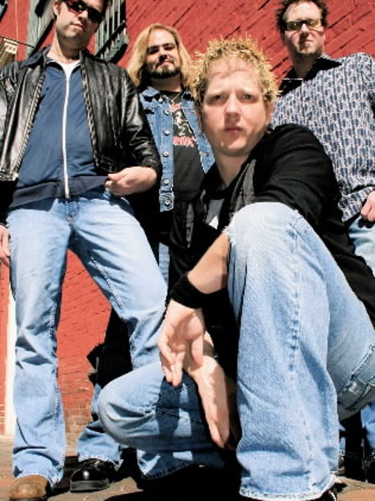 The Lancaster natives of Sugarcoat have been rocking the region for three years with a mix of original and cover material. You can t tell by looking, but one of these guys likes The Cure (hint: the third one). From left to right: Tim White, Chris Altland, B.J. Huss, Sean Sultzbach.