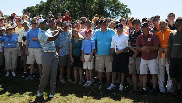 August 27, 2010. Tiger Woods hits over the green on