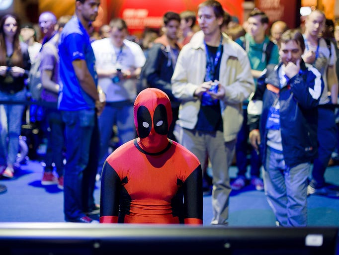 Game enthusiasts play with the latest game products from major and independent programmers at Eurogamer Expo 2013 at Earl's Court exhibition center on Sept. 26 in London.