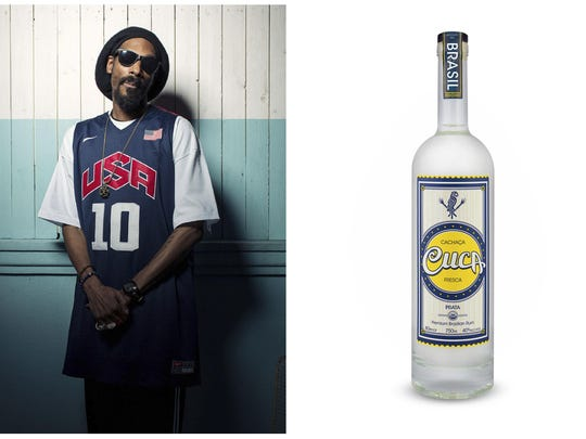 This combination photo shows Snoop Dogg posing for a portrait at Miss Lily's in New York on July 30, 2012, left, and a bottle of his Cuca Fresca Cachaça Prata.