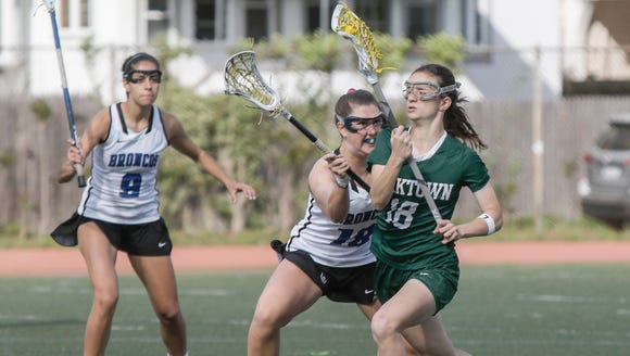Yorktown's Ellen O'Callaghan (18) tries to get past