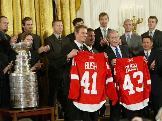 The 2008 Red Wings, the last Detroit major pro sports team to win a championship, visit the White House and then-President George W. Bush.