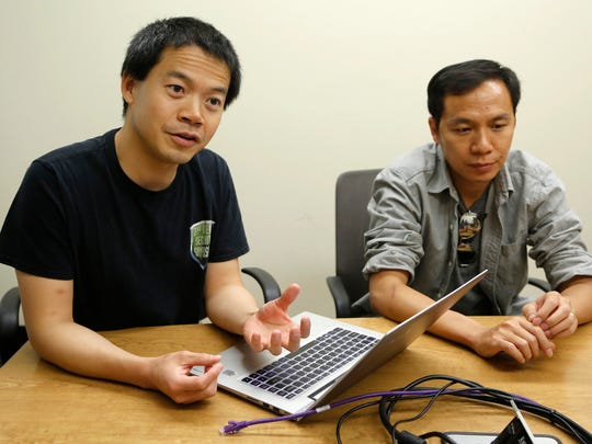 Dongyan Xu, left, and Xiangyu Zhang discuss the development of Retroscope Monday, August , 2016, at Purdue University. Retroscope can be used to retrieve information from cellphones.
