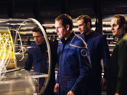 Lt. Reed (Dominic Keating), from left, Archer (Scott Bakula), Trip (Connor Trinneer) and Dr. Phlox (John Billingsley) peer at a strange alien pod they just saved from inside a regional space anomaly in 'Star Trek: Enterprise.'