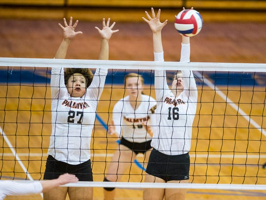 Palmyra's Kirstin West (27) and LeeAnn Baker go up for the block as Palmyra defeated Lower Dauphin in three sets in the quarterfinals of the District 3 Class 3A volleyball tournament on Tuesday, November 1, 2016.