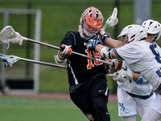 Central York's Chris Brandstedter is checked by Tre Blomeier of Manheim Township during the District 3 Class 3-A boys' lacrosse semifinal, on Tuesday, May 23, 2017. The Panthers lost just one starter from the 2017 championship team. John A. Pavoncello photo