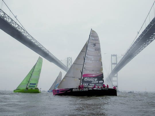 ** FILE ** Yachts competing in the Volvo Ocean Race sail south under the Chesapeake Bay Bridge in rain and fog at the start of the seventh leg of the race on April 28, 2002.  It was nearly a half-century ago that Gov. Theodore Roosevelt McKeldin christened the William Preston Lane Jr. Memorial Bridge, pulling together the Eastern and Western Shores of Maryland.  When it first opened to traffic on July 30, 1952, what's popularly known today as the Chesapeake Bay Bridge was the third-longest in the world. (AP Photo/Roberto Borea)