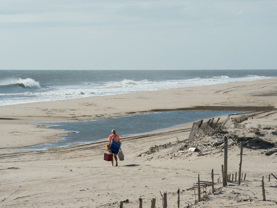 A beachgoer south of Dewey Beach a day after Hurricane