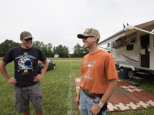 Brandon Reichlin, left, of Middletown, Del., and Adrian Wells Vargo of Lower Swatara, Pa., at their campsite for race weekend at Dover International Speedway.