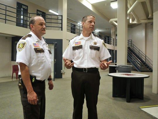 Sherburne County Jail Commander Patrick Carr, left,
