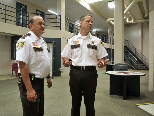 Sherburne County Jail Commander Patrick Carr, left,