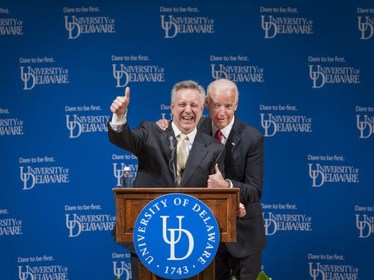 Former Vice President Joe Biden jokes with University of Delaware President Dr. Dennis Assanis as he grabs him by the shoulder during the ceremonial opening of the new Biden Institute at the University of Delaware's Roselle Center for the Arts in Newark in March 2017.