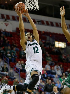 UW-Green Bay guard Carrington Love (12) drives to the basket past Cleveland State forward Derek Sloan (0) in the second half during Monday night's Horizon League game at the Resch Center in Ashwaubenon.