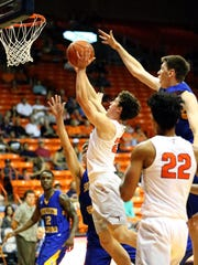 UTEP guard Trey Touchet goes up for a shot against