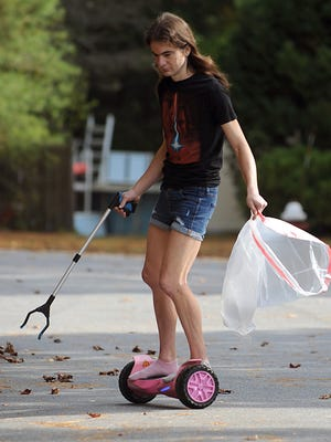 During the pandemic, Ray Costello has been collecting trash, gliding around town on his hoverboard, as he did here on Oct. 18.