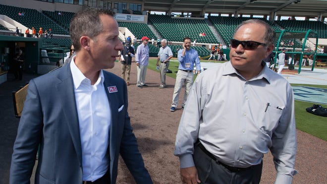 Tigers owner Chris Ilitch, left, and general manager Al Avila chat on Feb. 24, 2017 at Joker Marchant Stadium in Lakeland, Fla.