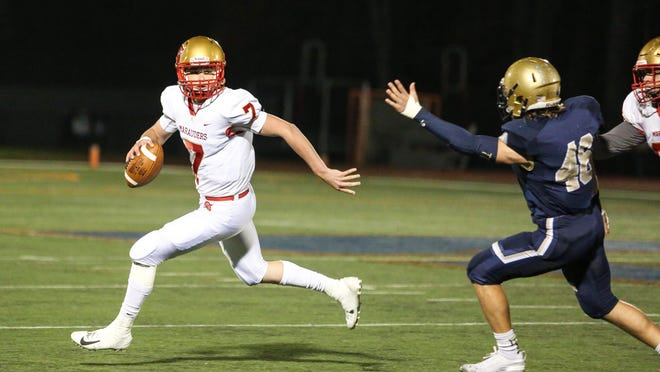 Mount Olive's QB Gavin Lockwood runs the ball as Roxbury defends during the first half of a football game at Roxbury High School on October 25, 2019.