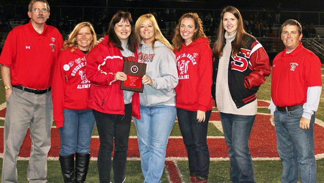 Jeanne Best, a resident of and volunteer with the Southern York County School District, received the Susquehannock Alumni Association's sixth annual Alumni Spirit Award. Among her accomplishments, Best served as cheerleading coach at the high school for a combined 29 seasons and was active in the All-Sports Booster Club for 14 years. Pictured at the presentation, held during the school's annual homecoming game, are, from left, Rob Lloyd, Susan Barnhart, Best, Cari Heyne, Anne Bozievich, Sarah Brown and Todd Stiffler.