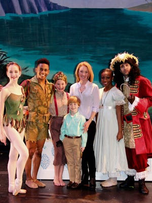 """From left, Catherine Cobb, Roderick Pitts-Phifer, Josie Aronov, Aaron Aronov, Loree Aronov, Ke'Yana Robinson, Raul Peinado, at the """"Meet Peter Pan and friends"""" party onstage after the Alabama Dance Theatre's Saturday matinee."""
