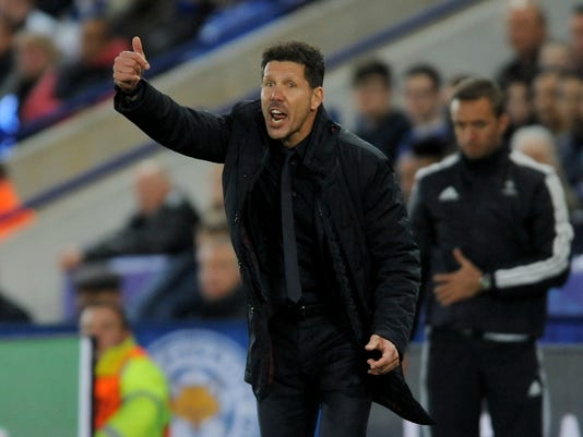Atletico Madrid manager Diego Simeone reacts during the Champions League quarterfinal second leg soccer match between Leicester City and Atletico Madrid at King Power Stadium, Leicester, England, Tuesday, April 18, 2017. (AP Photo/Rui Vieira)
