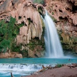 Water flows from Havasu Falls, one of the Havasupai waterfalls. Havasu Falls was damaged in a flash flood in August of 2008.