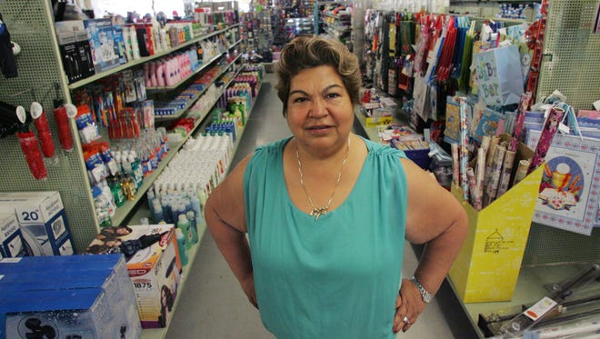 Anna Medina, co-owner of Ellie's Discount store in Fillmore, feels the U.S. economy can benefit from a system that allows immigrants who are already here to begin a legal path to legal status,