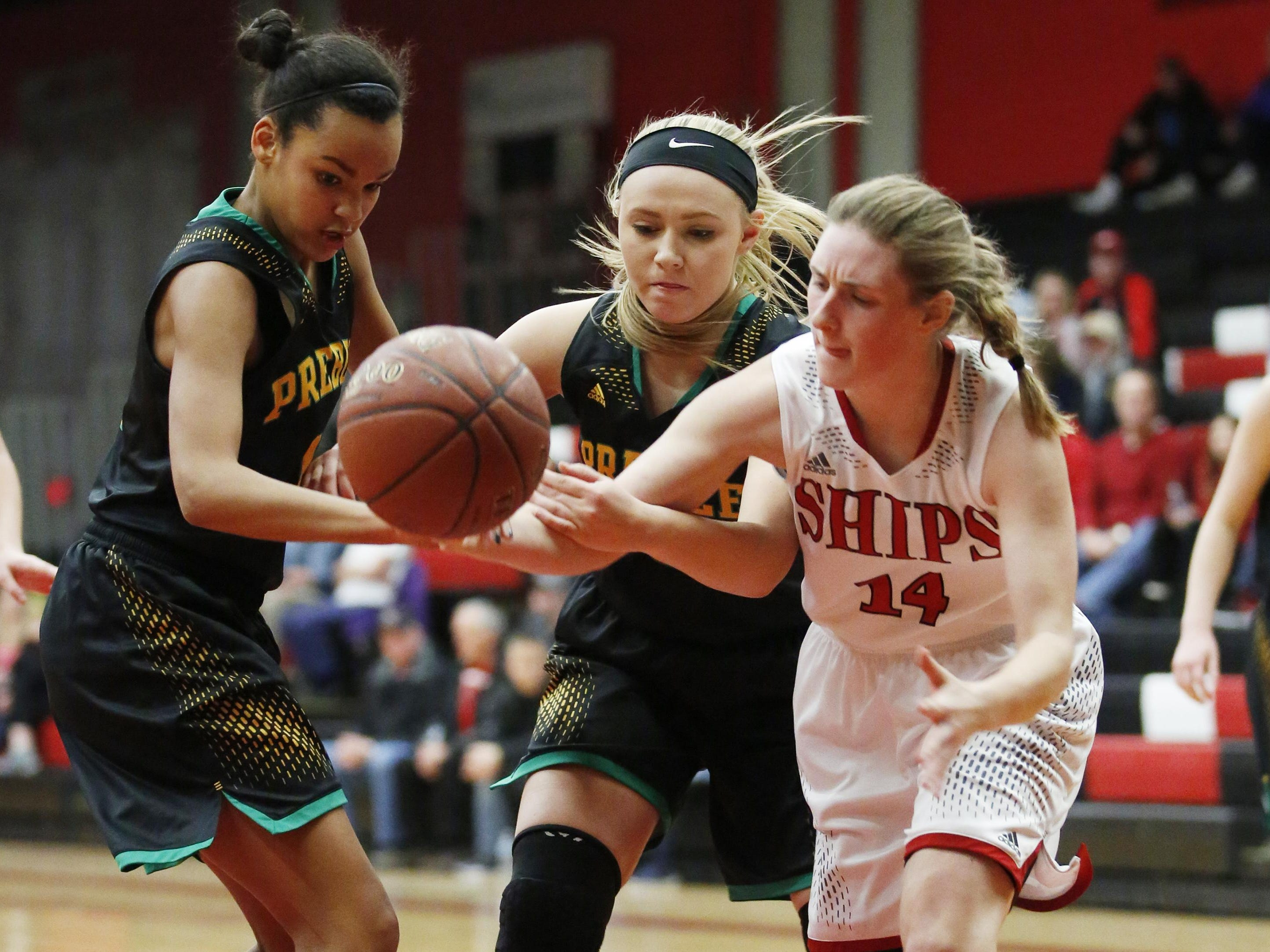 Green Bay Preble players battle with Manitowoc for a loose ball on Tuesday in Manty.