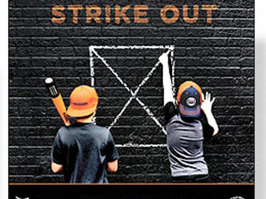 "The other side of the record features a shot of two boys playing ""Strike Out."" Daniel Norris shot the photograph."