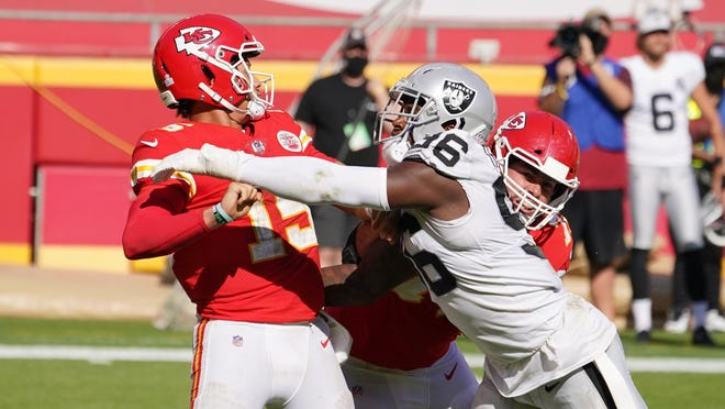 Kansas City Chiefs quarterback Patrick Mahomes, left, is hit by Las Vegas Raiders defensive end Clelin Ferrell (96) while throwing during the second half last week at Arrowhead Stadium in Kansas City, Mo.