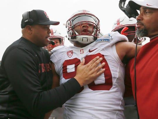 Stanford coach David Shaw congratulated defensive lineman