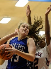 Alyssa Austin powers to the basket against Lebanon's