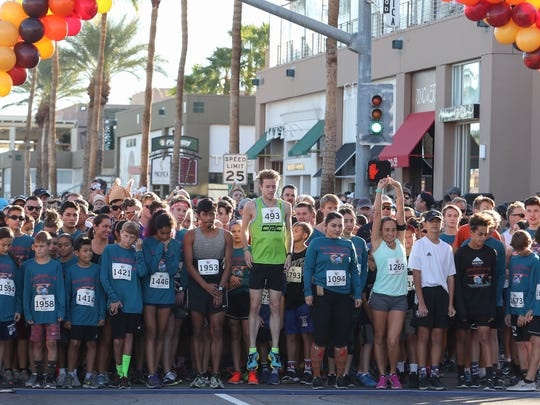 Taylor Hannegan, jumping, would go on to be the eventual winner of the 11th Annual Thanksgiving Day 5K benefiting Martha's Village and Kitchen in Palm Desert, November 23, 2017.
