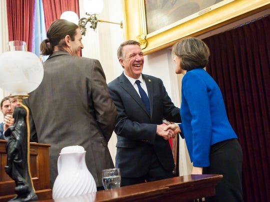 Gov. Phil Scott, center, shares a laugh with Lt. Gov.