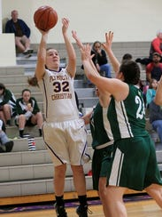 Kennedy Horne (32) of Plymouth Christian puts up a