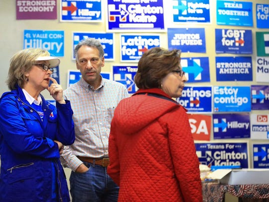 Members of the Nueces County Democratic Party watch television as the polls close on the East Coast on Tuesday, Nov. 8, 2016.