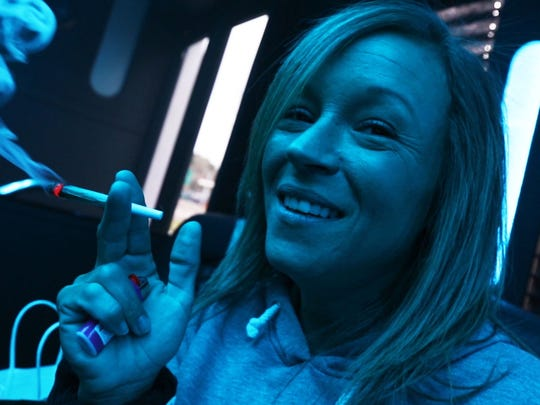 Colorado Cannabis Tours offers a wide range of entertainment for tourists interested in cannabis. This bus tour brings customers to grow facilities, dispensaries, and other attractions while and while offering  a legal means to consume the product. Mandy Ashby of Henderson, Kentucky enjoys the ride. 