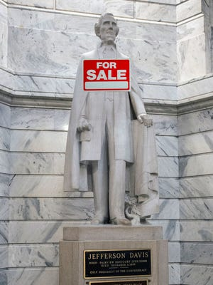Columnist Joseph Gerth proposes selling off Kentucky's Confederate monuments, like the Jefferson Davis statue in the Kentucky Capitol rotunda, to make some extra cash.