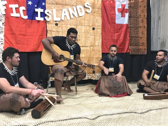 Bethel School of Supernatural Ministry student Morgan Faleolo, from left, plays with fellow musicians Peni Tapaweluwelu, John Pu'e and Kelemedi Silikiwai on Saturday at the Pacific Islands booth during the Festival of Cultures inside the Redding Civic Auditorium. Bethel Church hosted the event with its international students serving their native cuisine while wearing their country's garb. Faleolo was born in New Zealand and is Samoan. Tapaweluwelu is a church member from Fiji. Pu'e is from American Samoa (Tutuila) and Silikiwai is from Fiji and Hawaii. Both are Bethel ministry students.