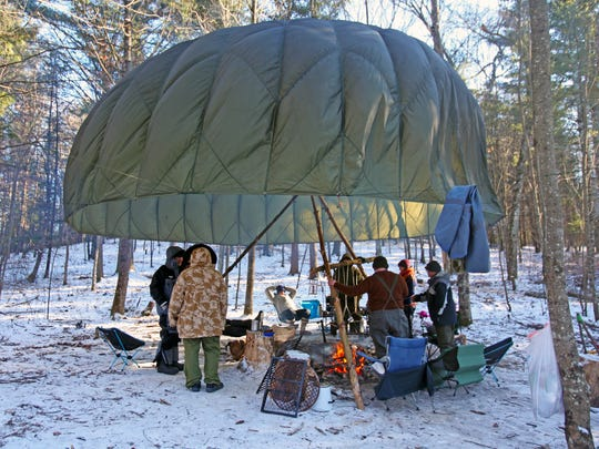 A parachute helps trap heat from the fire at the Frozen